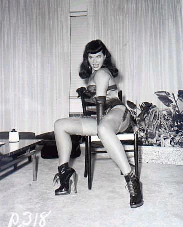 Bettie Page at her most sweet & fearsome.